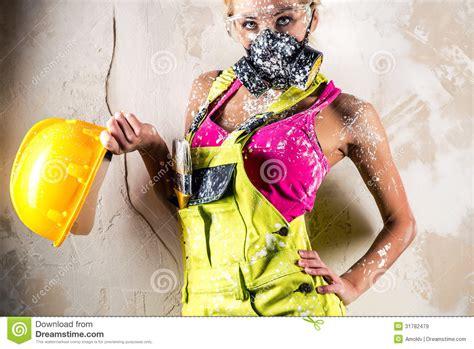 female wearing a respirator posing indoors stock image