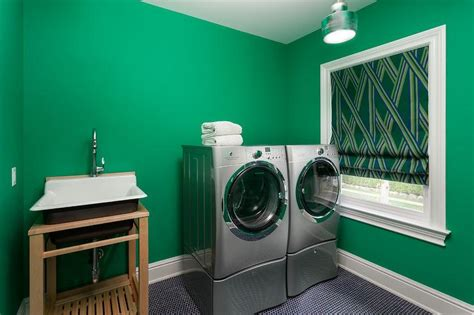 kelly green laundry room  black penny tile floor