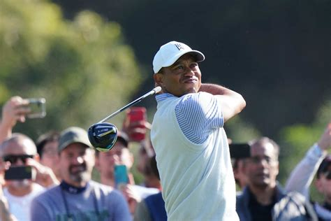 Tiger Woods slips down leader board with two-over 73 on ...