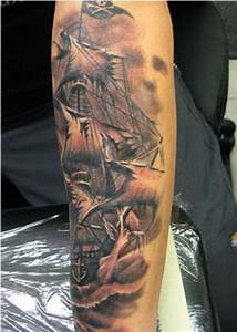 Black And Grey Pirate Ship Tattoo On Arm