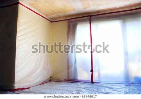 room covered clear plastic sheeting  stock photo