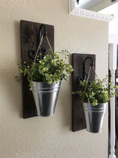 These galvanized metal wall pockets perfectly display floral and add a touch of industrial texture. Galvanized Metal Decor Metal Wall Decor Sconce with Flowers
