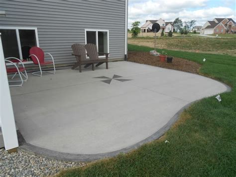 Backyard Concrete Ideas by Simple Concrete Patio Ideas With Chair And Brown Chair