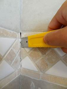 How to repair cracked bathroom tile grout chartssky for Cracked bathroom tile repair