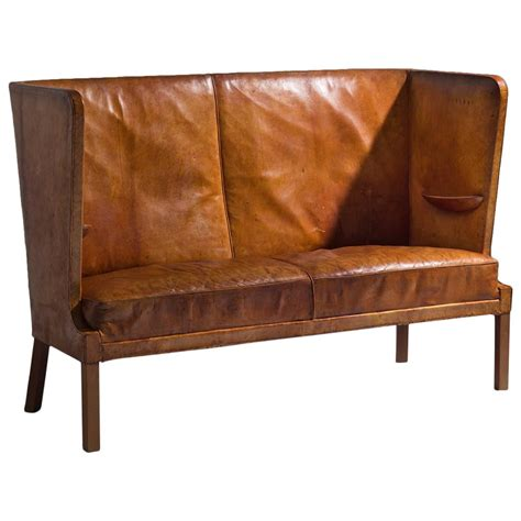 High Backed Settee by Frits Henningsen Early High Backed Sofa In Original Cognac