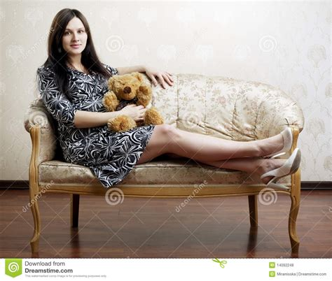 pregnant woman sitting   vintage couch royalty
