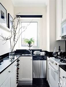 9 beautiful black and white kitchens from the ad archives for Kitchen colors with white cabinets with joshua 1 9 wall art