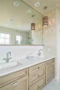 Contemporary pendant lights above bathroom sink