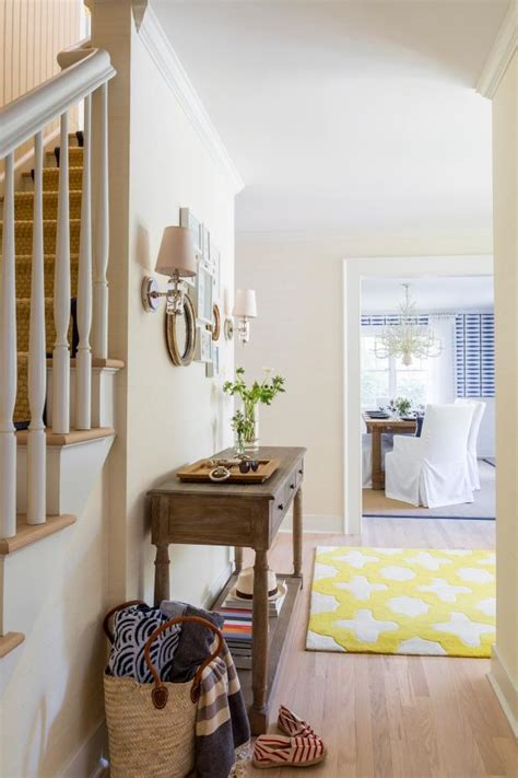 neutral transitional foyer  yellow rug hgtv