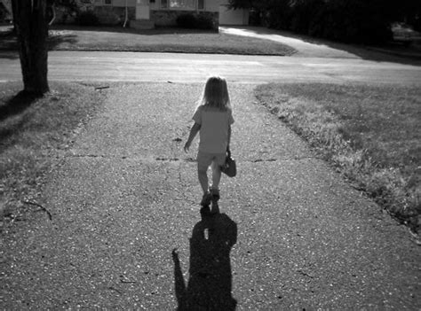 Sad Girl Walking On A Path In A Park.