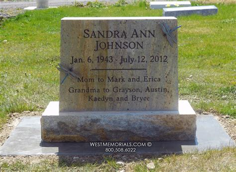 johnson yellow and gold headstone with bronze dragonflies