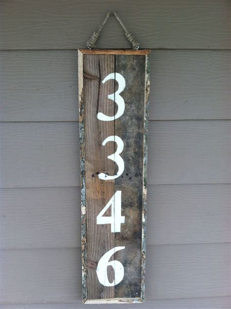 address sign   reclaimed pallet wood house