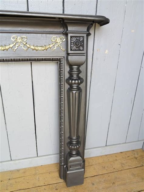 fireplace mantels and surrounds classic cast iron surround with brass ribbon detail 7208