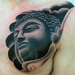 Blackwork style medium sized Buddha statue tattoo on chest ...