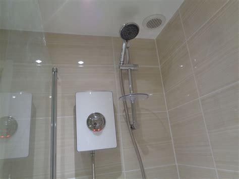 Shower The - beige bathroom with combined storage washbasin and toilet