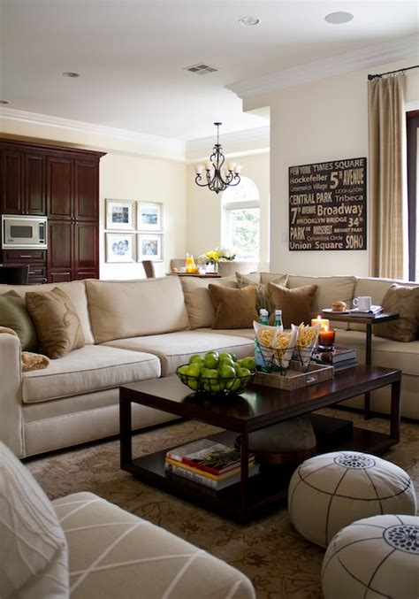 living room brown and beige large beige sectional with brown and green accent pillows creamy neutral walls with tonal silk