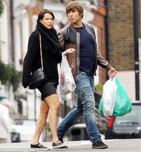 fray scarf liam gallagher displays fuller figure with