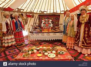 Women in traditional costume Bashkir yurt interior ...
