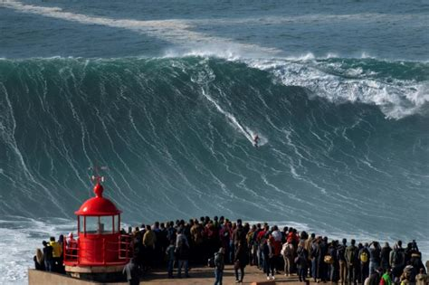 extreme surfers catch record waves  portuguese town