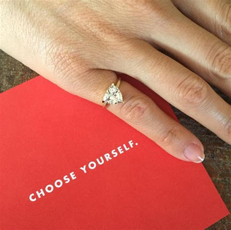 women wear engagement rings on their pinkies to symbolize