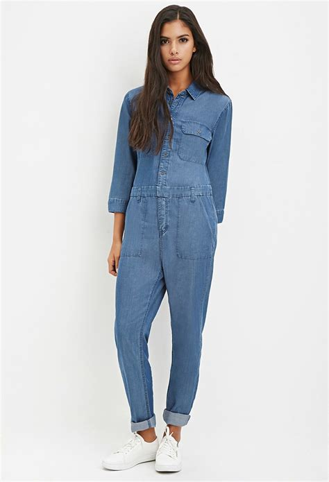 forever 21 denim jumpsuit forever 21 button denim jumpsuit in blue lyst