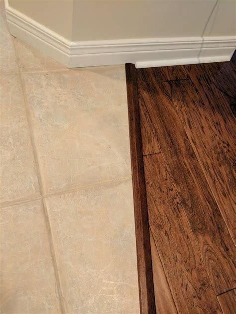 transitioning hardwood floor  tile floor