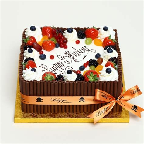 fresh fresh fruit square gateau with mixed chocolate decorations