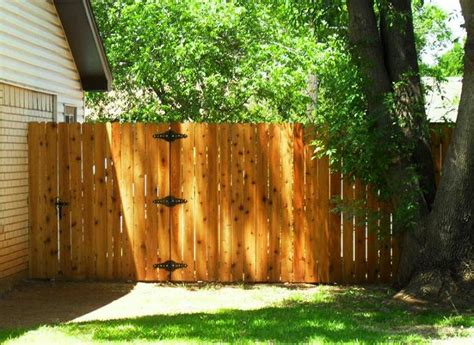 olympic maximum cedar naturaltone stain fence stained on