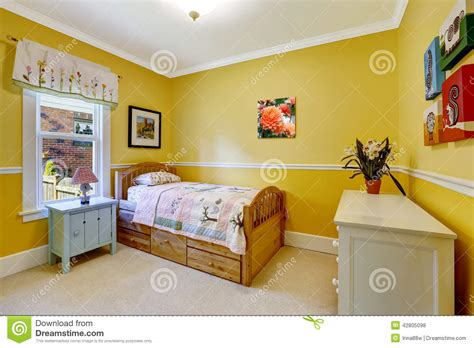happy kids room  bright yellow stock photo image