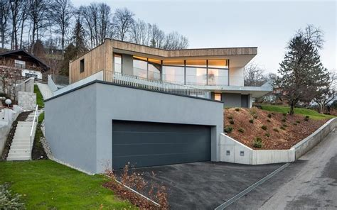 storey home  steep slope  grass roofed garage hillside house storey homes houses