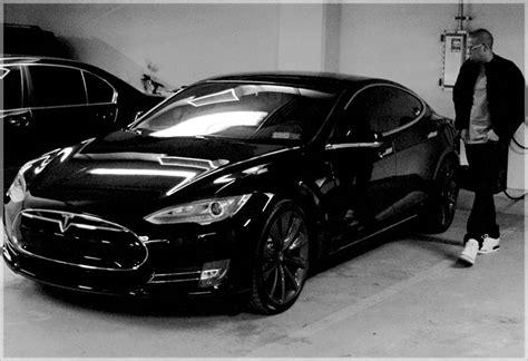 jay  drives  black  black tesla model  gas