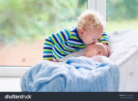 Cute Little Boy Kissing His Newborn Stock Photo 315740261 Sheepskin Baby Blanket Safety Blue Striped Fleece Crochet Borders For Boy Blankets National Park Wool White Double Bed Easiest Knit Merino Canada Best Size Receiving Swaddling