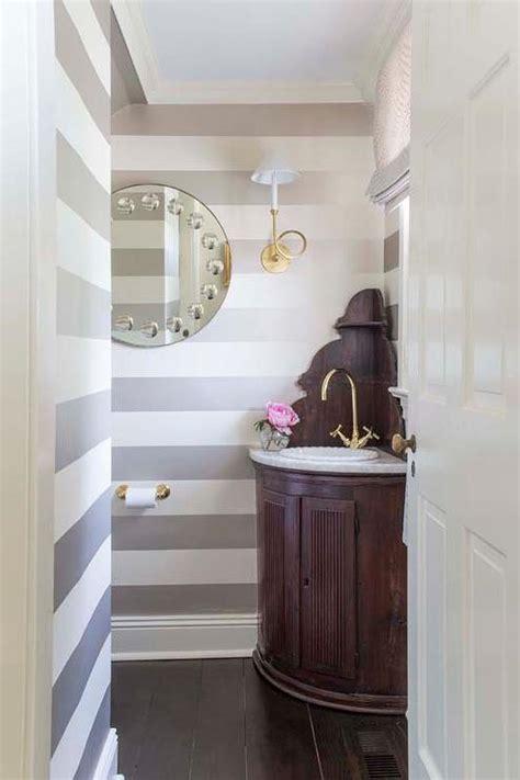 key corner mirror  glass sconces transitional bathroom