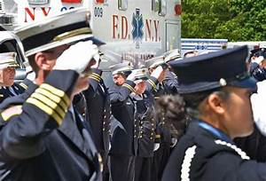 Emergency Medical Services (EMS) personnel salute during ...