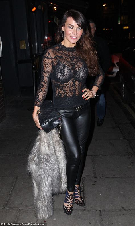 lace dress lizzie cundy flashes bra underneath sheer lace top as she