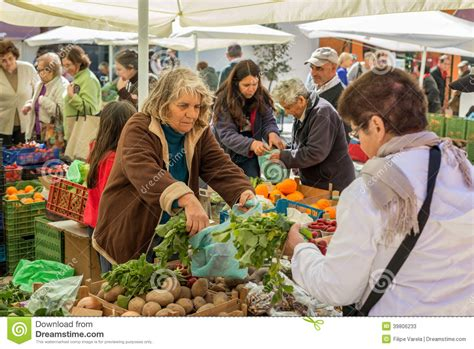 People Selling And Buying In A Traditional Farmers Market