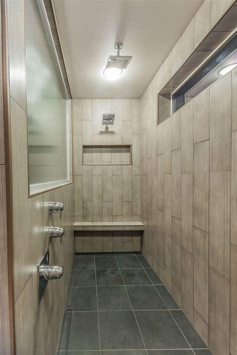 long shower  vertical tile walls  shower pan