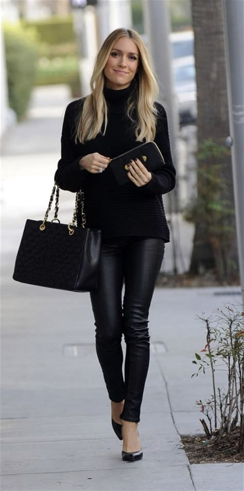 I LOVE this outfit - I wear black everything anyways but I am totally digging the leather pants ...
