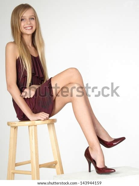 blond teen girl posing dress heels stock photo edit