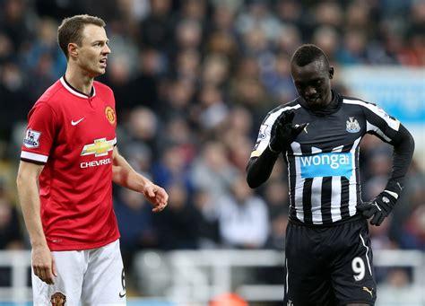 Manchester United defender Jonny Evans and Newcastle ...