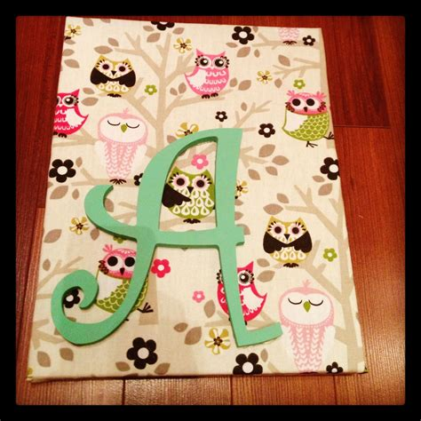 spray adhesive   canvas  fabric  top painted letter hot glued   crafts