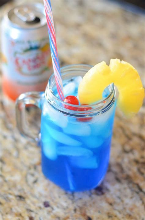 Learn more about our products, delicious rum cocktails and drink recipes. The mandarin malibu blue | Recipe | Drinks with pineapple ...