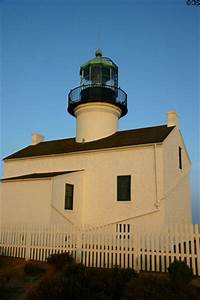 Old Point Loma Lighthouse in sunset light at Cabrillo ...