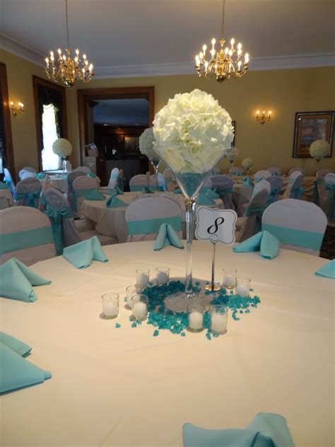 tiffany blue table decorations oversize martini glasses with white flower orbs create a