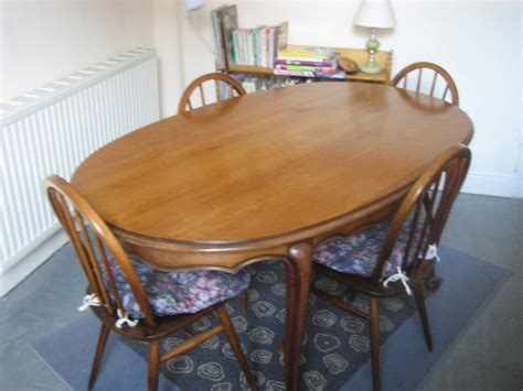 set  ercol chairs  oval solid wood dining table