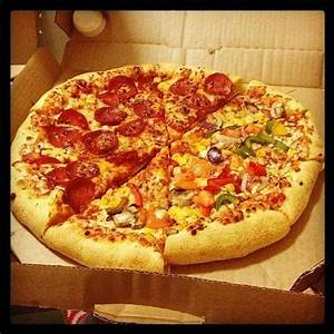 half pepperoni and half chicken deluxe (i think) and ...