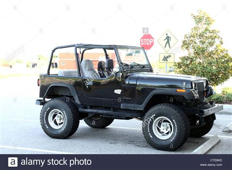 old jeep old black cj jeep with big wheels stock photo royalty