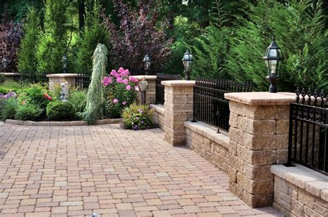 brick wall front yard the wrought iron railing on top of the knee wall between the pillars creates a custom patio