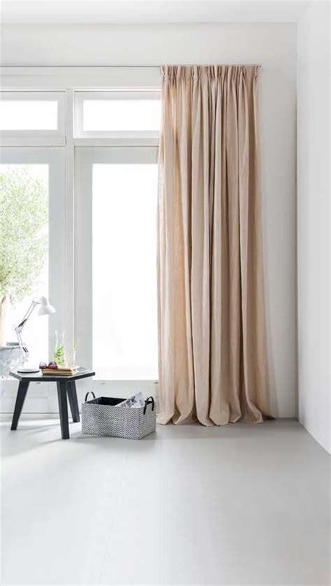 gordijnen mooi ophangen karwei mooie raamdecoratie zorgt voor een warme sfeer in