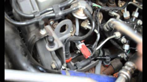 como cambiar los calentadores al coche ford focus  tdci